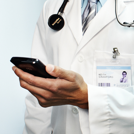 Doctor using a mobile device