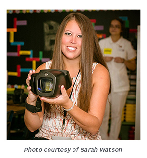 Sarah Watson holding Welch Allyn Spot Vision Screener