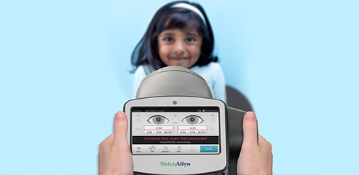 Screen view of Spot Vision Screener with child in background